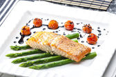 Baked salmon with green asparagus and cherry tomatoes — Stock Photo