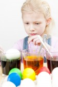 Portrait of little girl during Easter eggs'' coloration — Stock Photo