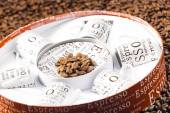 Coffee cups stored in a box on coffee beans — Stock Photo