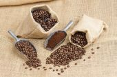 Still life of coffee beans in jute bags — Stock Photo