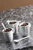 Coffee cups full of coffee beans — ストック写真