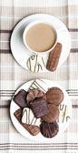 Tasse kaffee mit gebäck — Stockfoto