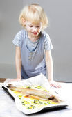 Little girl with baked trout salmon — Stock Photo