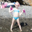Little girl on the beach at sea ready for snorkeling — Stock Photo #57914971