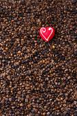 Coffee beans and marzipan heart — Stock Photo
