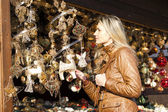 Woman at Christmas market — Stock Photo