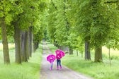 Mother and her daughter with umbrellas — Stock Photo