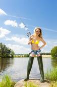 Young woman fishing at pond in summer — Foto de Stock