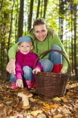 Mother with her daughter doing mushroom picking — Stock Photo