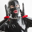 Portrait of woman wearing latex clothes with handcuffs — Stock Photo #69085331