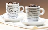 Coffee cups full of coffee beans — Stock Photo