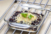 Baked black beans with cheese Emmentaler — Stock Photo