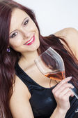 Portrait of young woman with a glass of rose wine — Stock Photo