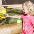 Little girl playing at fountain, Ajonc — Stock Photo #69705515
