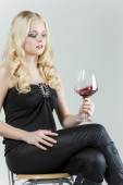 Woman with a glass of red wine — Stock Photo