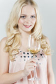 Young woman with a glass of white wine — Stock Photo