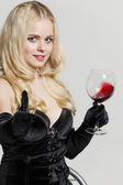 Young woman with a glass of red wine — Stock Photo