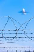 Barbed wires at the airport — Stock Photo