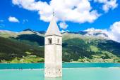 Tower of sunken church in Resia lake, South Tyrol, Italy — Stock Photo