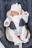 Newborn baby girl in a car seat — Stock Photo