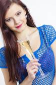 Portrait of young woman with a glass of champagne — Stock Photo