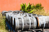 Casks in front of wine cellar, Languedoc-Roussillon, France — Stock Photo
