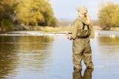 Woman fishing in the river in spring — Stock Photo