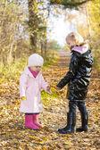 Little girls wearing rubber boots — Stock Photo