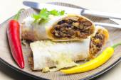 Burrito filled with beef minced meat and beans baked with gouda  — Stock Photo