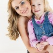 Portrait of little girl with her mother — Stock Photo #76711701