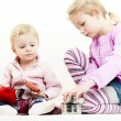 Two little girls playing with child dishes — Stock Photo #76712867
