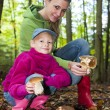 Mother with her daughter doing mushroom picking — Stock Photo #78955600