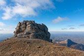 Rock in autumn mountains — Stock Photo