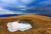 Snow on meadow in Carpathians — Stock Photo