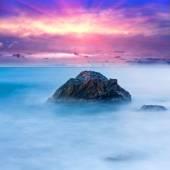 Stone in sea — Stock Photo