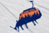 Chairlift's  shadow on snow — Stock Photo