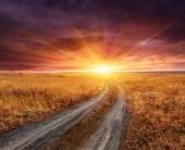 Rut road to sunset — Stock Photo