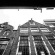 Facades of houses in old city in Amsterdam — Stock Photo #59469867