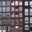 Facades of houses in old city in Amsterdam — Stock Photo #59469937