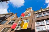 Facades of houses in old city in Amsterdam — Stock Photo