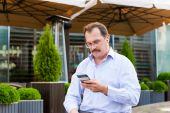 Middle age businessman using smartfone — Stock Photo
