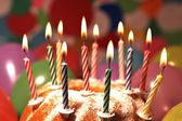 Happy Birthday - candle flames on a cake — Stock Photo