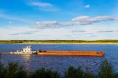 Barge on river — Stock Photo