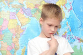 Little boy near the wall map — Stock Photo