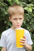 Boy drinking milk-shake — Stock Photo