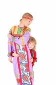 Girl and boy in russian folk clothes — Stock Photo