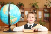 Little boy with book and globe — Stock Photo