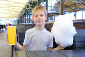 Boy with cotton candy — Stock Photo