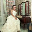 Beautiful bride sitting — Stock Photo #69933479