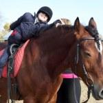 Boy making exercises on the horseback — Stock Photo #73549677